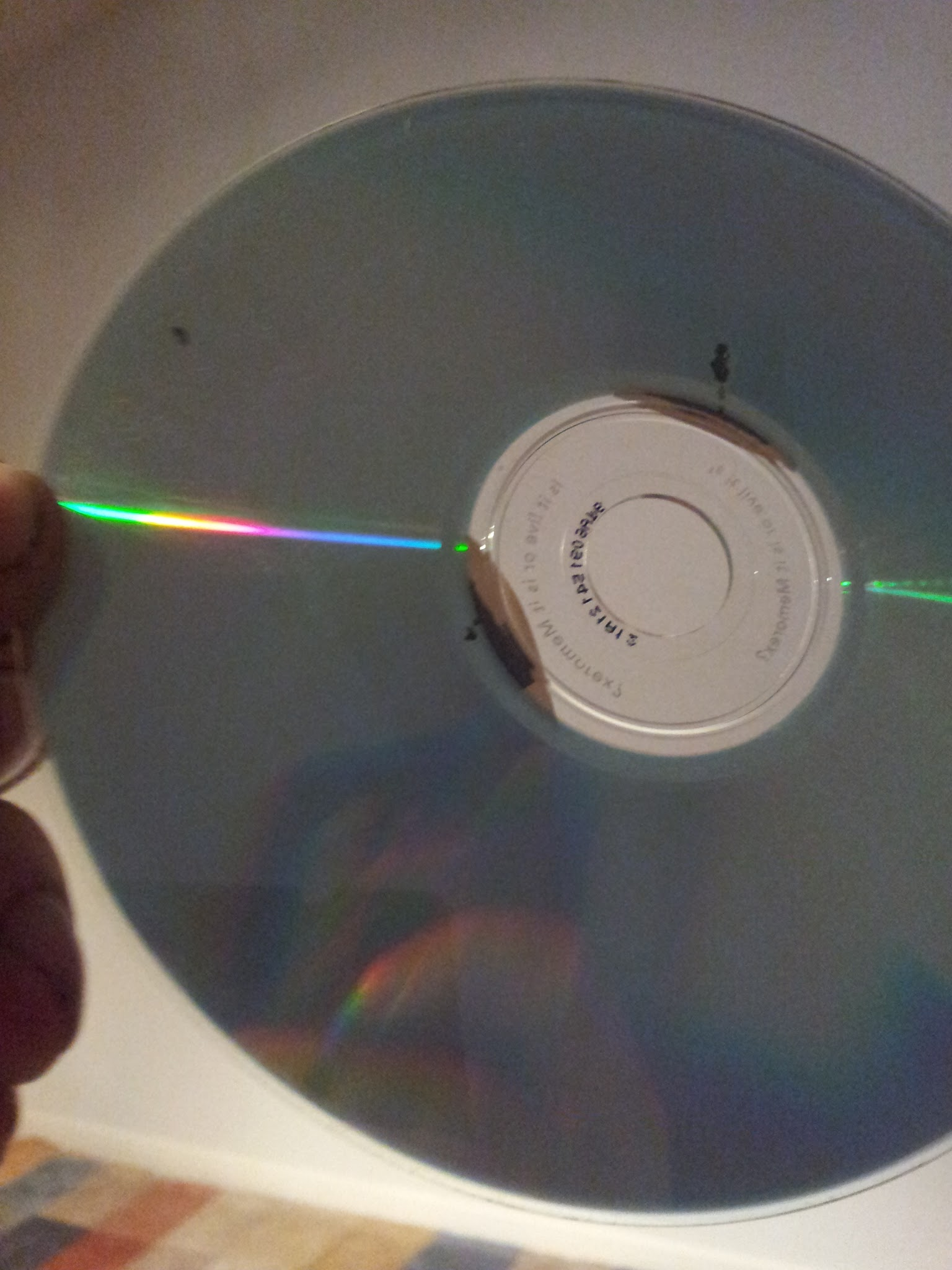Data side of the CD showing holes in the data foil